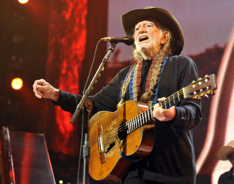 FILE - This Sept. 21, 2013 file photo shows Willie Nelson performing during the Farm Aid 2013 concert at Saratoga Performing Arts Center in Saratoga Springs, N.Y. Nelson has been forced to pull out of the Southern Ground Music & Food Festival and three other shows due to a shoulder injury. Nelson's publicist says Wednesday the 80-year-old country music star is under a doctor's orders to rest his shoulder for a week, meaning he'll miss shows in Carmel, Ind., Charlotte, Mich., Springfield, Ill., and Saturday's appearance at the festival hosted by Zac Brown in Nashville, Tenn. (AP Photo/Hans Pennink, File)