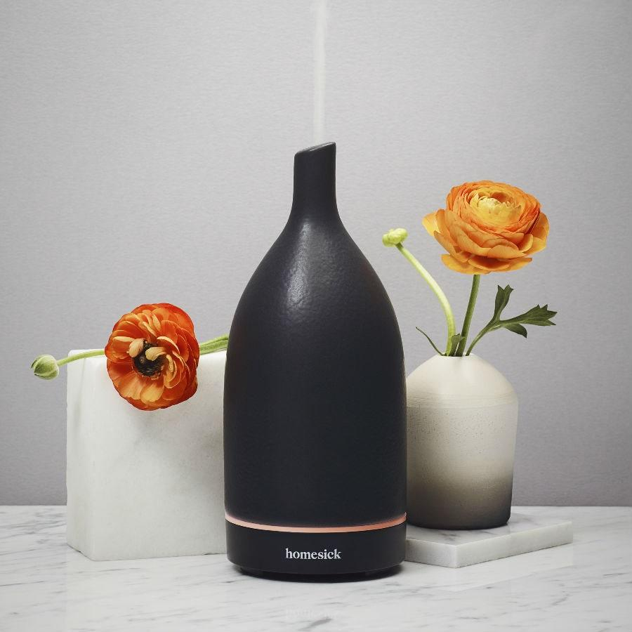 "<p>Do you miss the way Central Park smells in the springtime? Or the way that the wind catches the salty sea breeze in Southern California? If that's the case, you'll <em>really</em> love this diffuser from Homesick, the brand that brought you candles based off the scents of your hometown. The device itself offers ultrasonic vibrations, a tank that holds enough water for six hours of diffusing, two operation modes for either strong or standard misting, and a soft LED light to set the mood.</p> <p>$90 (<strong><a href=""https://amzn.to/32NJiJ6"" rel=""nofollow"">Shop Now</a></strong>)</p>"