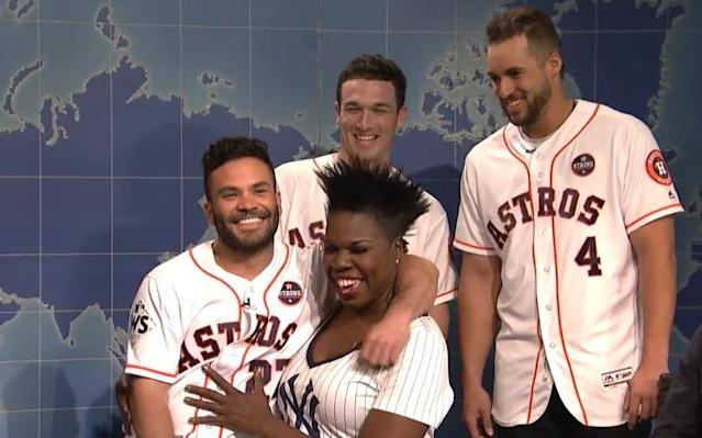 Houston Astros second baseman Jose Altuve sits on comedian Leslie Jones' lap on Saturday Night Live, and they both seem to be enjoying it a lot. (NBC screen shot)