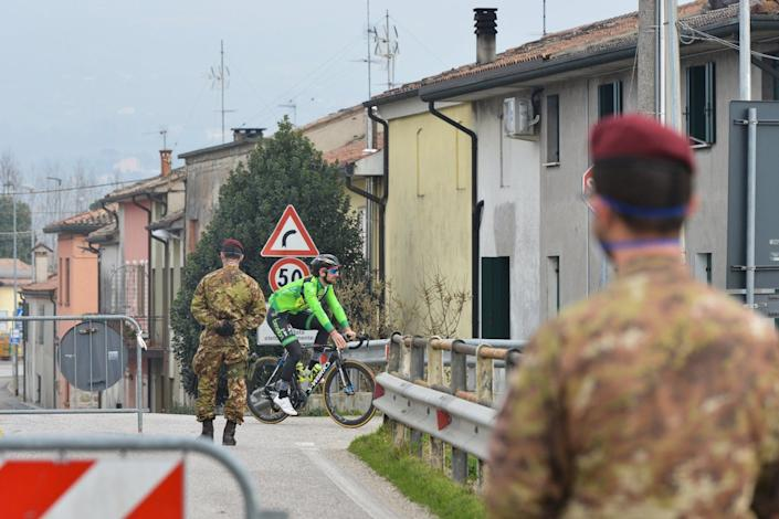 Italian troops near a checkpoint at the entrance of the small Northern Italian town of Vo Euganeo, situated in the red zone of the coronavirus outbreak, on February 24.