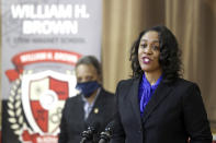 William H. Brown Elementary School principal Latoya Lyons speaks during a news conference Thursday, Feb. 11, 2021, after Chicago Mayor Lori E. Lightfoot, left, and others toured the school in Chicago. In-person learning for students in pre-k and cluster programs began Thursday, since the district's agreement with the Chicago Teachers Union was reached. (AP Photo/Shafkat Anowar, Pool)