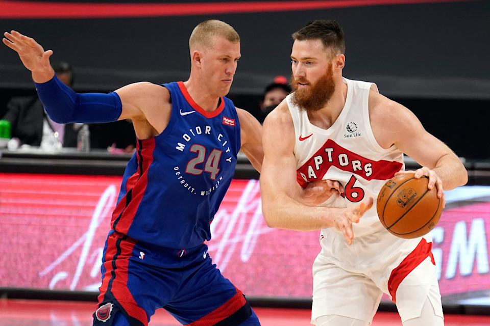 Raptors center Aron Baynes works in against Pistons center Mason Plumlee during the first half in Tampa, Florida, on Wednesday, March 3, 2021.