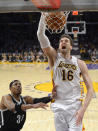 Los Angeles Lakers center Pau Gasol, right, of Spain, dunks as Brooklyn Nets forward Paul Pierce defends during the second half of an NBA basketball game, Sunday, Feb. 23, 2014, in Los Angeles. The Nets won 108-102. (AP Photo/Mark J. Terrill)