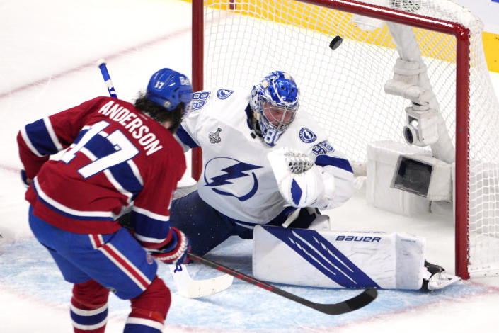 Montreal Canadiens right wing Josh Anderson (17) scores past Tampa Bay Lightning goaltender Andrei Vasilevskiy (88) during the first period of Game 4 of the NHL hockey Stanley Cup final in Montreal, Monday, July 5, 2021. (Paul Chiasson/The Canadian Press via AP)