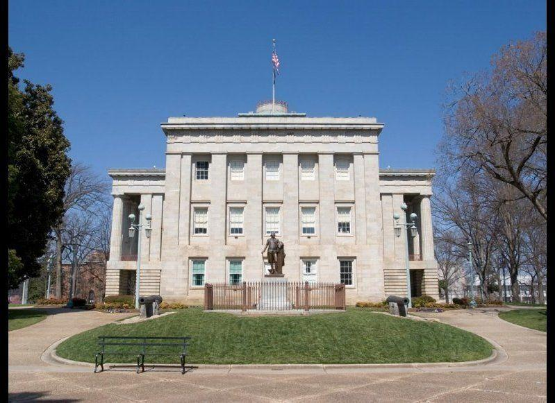 <strong>NORTH CAROLINA STATE CAPITOL</strong> Raleigh, North Carolina <strong>Year completed:</strong> 1840 <strong>Architectural style: </strong>Greek Revival <strong>FYI: </strong>The North Carolina State Capitol boasts two impressive statues of George Washington. Outside on the grounds sits a bronze statue cast from a mold of Jean-Antoine Houdon's statue of George Washington in Richmond, Virginia. At the focal point in the rotunda, there's a copy of a statute that stood at North Carolina's previous state capitol until 1831. The Italian sculptor, Antionio Canova, carved George with a Roman general's uniform and haircut—and he's writing in Italian. <strong>Visit:</strong> Self-guided tours are available Monday to Friday, 8 a.m. to 5 p.m.; Saturday, 9 a.m. to 5 pm; and Sunday, 1 p.m. to 4 p.m. Guided tours for groups of 10 can be scheduled through Capital Area Visitor Services.