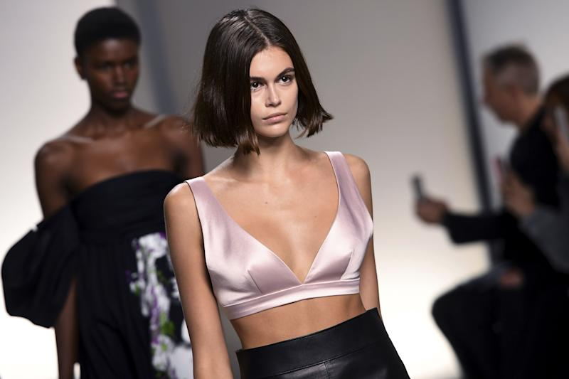 US model Kaia Gerber presents a creation by Givenchy during the Women's Spring-Summer 2020 Ready-to-Wear collection fashion show at the Garde Republicaine in Paris, on September 29, 2019. (Photo by Christophe ARCHAMBAULT / AFP) (Photo credit should read CHRISTOPHE ARCHAMBAULT/AFP/Getty Images)