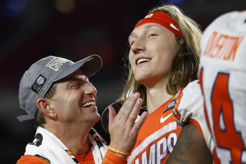 Clemson coach Dabo Swinney celebrates with quarterback Trevor Lawrence after Clemson defeated Ohio State 29-23 in the Fiesta Bowl NCAA college football playoff semifinal Saturday, Dec. 28, 2019, in Glendale, Ariz. (AP Photo/Ross D. Franklin)
