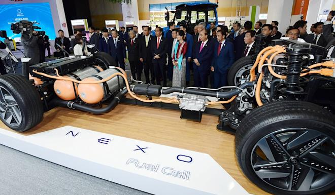 The leaders of South Korea and Asean countries are introduced to a Hyundai hydrogen fuel cell electric car on Tuesday. Photo: EPA-EFE