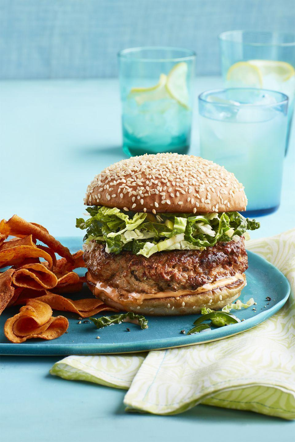 "<p>Packed with good-for-you spices, these turkey patties, topped with a sweet and crunchy apple and cabbage slaw, are a healthy alternative to <a href=""https://www.heart.org/en/healthy-living/healthy-eating/eat-smart/nutrition-basics/meat-poultry-and-fish-picking-healthy-proteins"" rel=""nofollow noopener"" target=""_blank"" data-ylk=""slk:red meat"" class=""link rapid-noclick-resp"">red meat</a>.</p><p><a href=""https://www.womansday.com/food-recipes/food-drinks/recipes/a59376/turkey-burgers-slaw-sweet-potato-chips/"" rel=""nofollow noopener"" target=""_blank"" data-ylk=""slk:Get the Turkey Burgers and Slaw with Sweet Potato Chips recipe."" class=""link rapid-noclick-resp""><em><strong>Get the Turkey Burgers and Slaw with Sweet Potato Chips recipe.</strong></em></a></p><p><b><a class=""link rapid-noclick-resp"" href=""https://www.amazon.com/Lavatools-PT12-Javelin-Thermometer-Chipotle/dp/B00GRFHXVQ/?tag=syn-yahoo-20&ascsubtag=%5Bartid%7C10070.g.2176%5Bsrc%7Cyahoo-us"" rel=""nofollow noopener"" target=""_blank"" data-ylk=""slk:SHOP INSTANT-READ THERMOMETERS"">SHOP INSTANT-READ THERMOMETERS</a></b></p>"