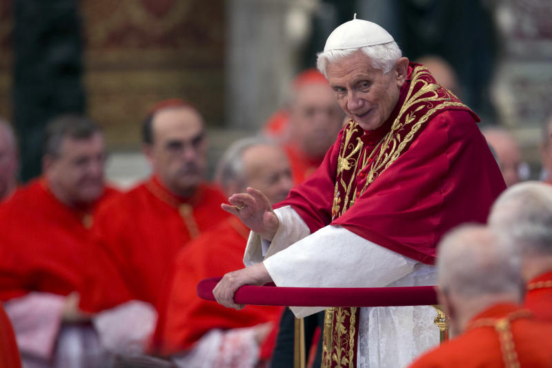 Pope Benedict XVI makes his way through cardinals as he arrives inside St. Peter's Basilica at the Vatican to preside over a consistory, Saturday, Nov. 24, 2012. Six new cardinals are joining the elite club of churchmen who will elect the next pope, bringing a more geographically diverse mix into the European-dominated College of Cardinals. The new cardinals are: Archbishop James Harvey, the American prefect of the papal household; Abuja, Nigeria Archbishop John Olorunfemi Onaiyekan; Bogota, Colombia Archbishop Ruben Salazar Gomez; Manila, Philippines Archbishop Luis Antonio Tagle; Patriarch of Antioch of the Maronites in Lebanon, His Beatitude Bechara Boutros Rai; and the major Archbishop of the Trivandrum of the Siro-Malankaresi in India, His Beatitude Baselios Cleemis Thottunkal. (AP Photo/Andrew Medichini)