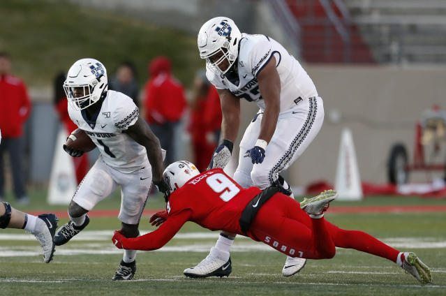Utah State running back Gerold Bright (1) breaks the tackle by New Mexico safety Jerrick Reed (9) during the second half of an NCAA college football game on Saturday, Nov. 30, 2019 in Albuquerque, N.M. (AP Photo/Andres Leighton)