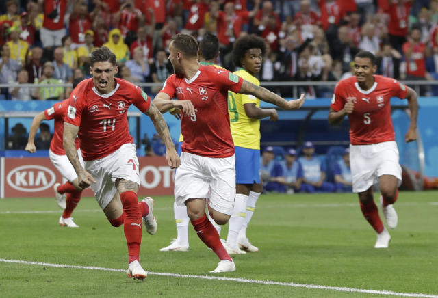 Switzerland's Steven Zuber, left, celebrates with teammates after scoring his side's opening goal during the group E match between Brazil and Switzerland at the 2018 soccer World Cup in the Rostov Arena in Rostov-on-Don, Russia, Sunday, June 17, 2018. (AP Photo/Themba Hadebe)