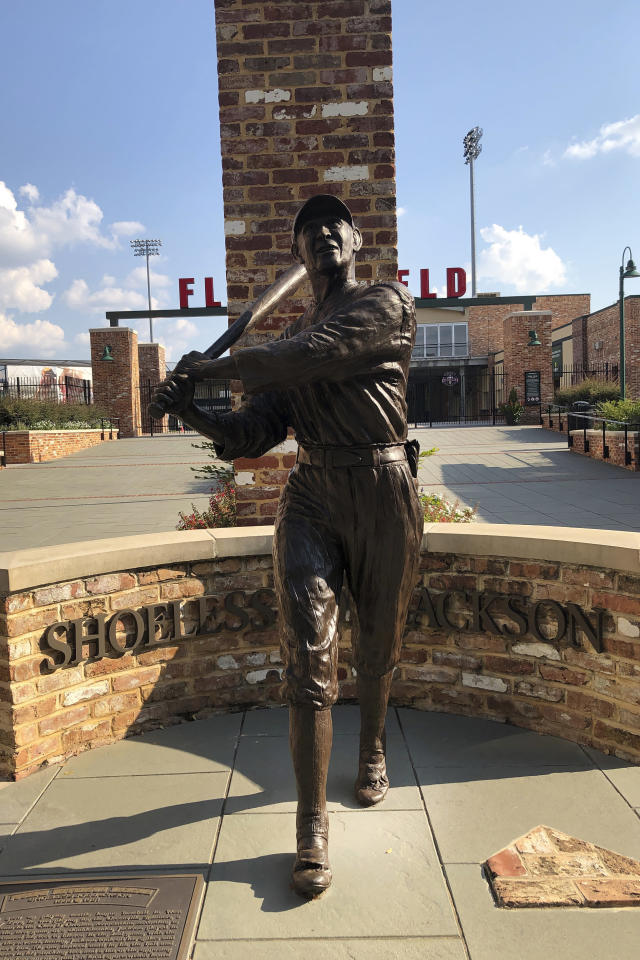 In this Sept. 29, 2019, photo, a statue of Shoeless Joe Jackson stands in front Fluor Stadium in Greenville, S.C. (AP Photo/Paul Newberry)