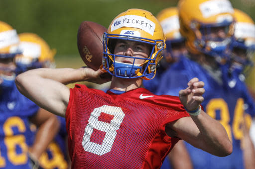 FILE - This Aug. 2, 2019, file photo shows Pittsburgh quarterback Kenny Pickett as he passes in a drill during an NCAA football practice in Pittsburgh. A preseason poll has projected Pitt to finish 4th in their ACC Coastal Division after being the division champion last season. (AP Photo/Keith Srakocic, File)