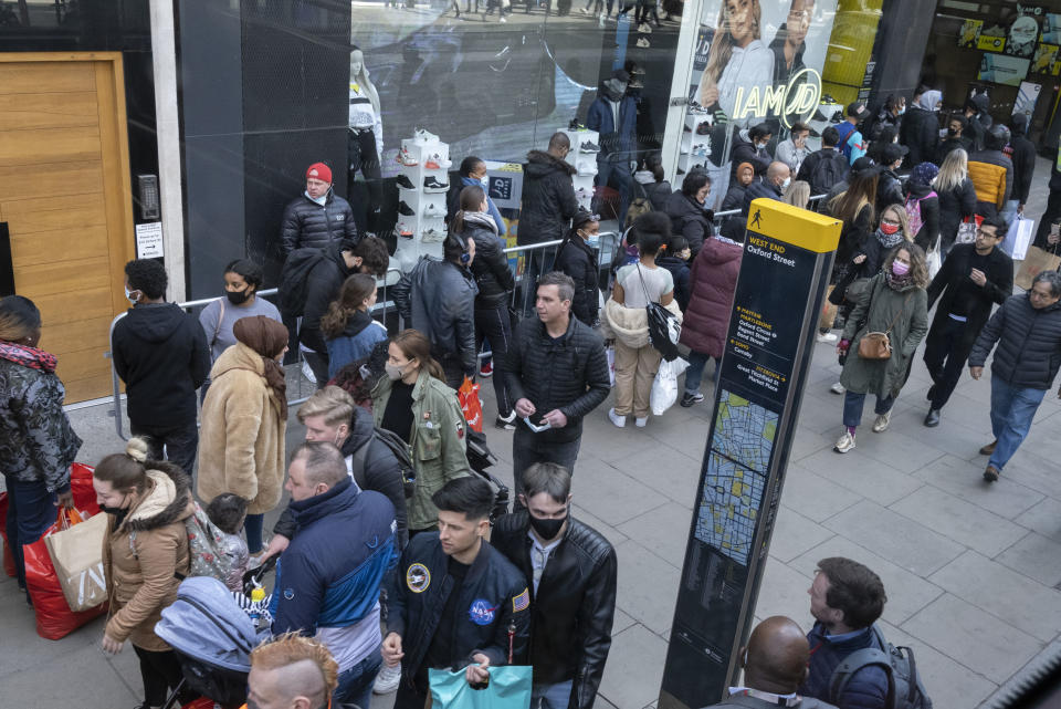 On the day that the UK government eased Covid restrictions to allow non-essential businesses such as shops, pubs, bars, gyms and hairdressers to re-open, crowds of shoppers walk on Oxford Street, on 12th April 2021, in London, England. (Photo by Richard Baker / In Pictures via Getty Images)
