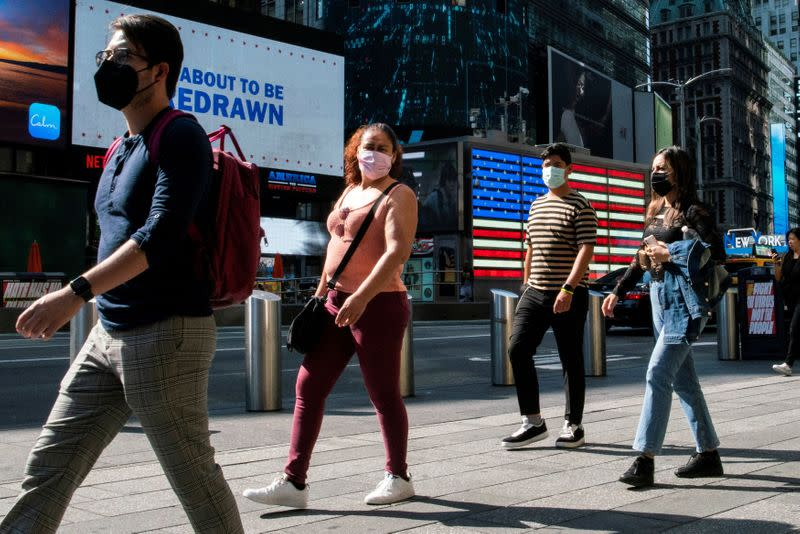 FILE PHOTO: People wear masks around Times Square, as cases of the infectious coronavirus Delta variant continue to rise in New York City, New York