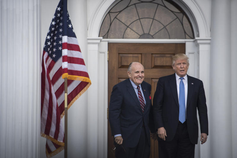 BEDMINSTER TOWNSHIP NJ- NOVEMBER 20 President-elect Donald Trump greets Rudy Giuliani at the clubhouse at Trump National Golf Club Bedminster in Bedminster Township N.J. on Sunday Nov. 20 2016
