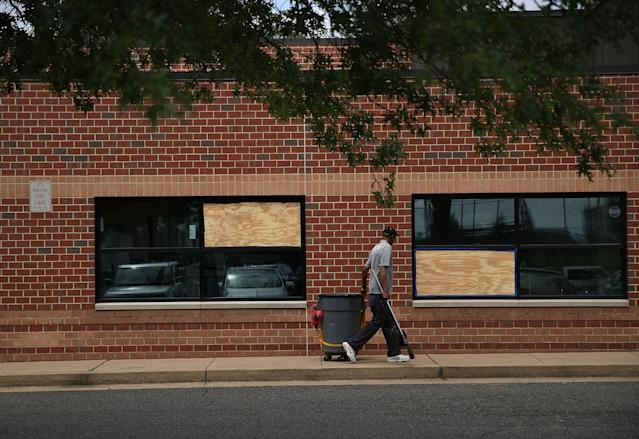 <p>Two windows at the YMCA building broken by bullets are shown boarded up near the Eugene Simpson Stadium Park, the site where House Majority Whip Rep. Steve Scalise was shot by gunman James Hodgkinson, June 19, 2017 in Alexandria, Va. Investigators have concluded their investigation at the shooting scene and the area has been reopened to the public. (Photo: Alex Wong/Getty Images) </p>