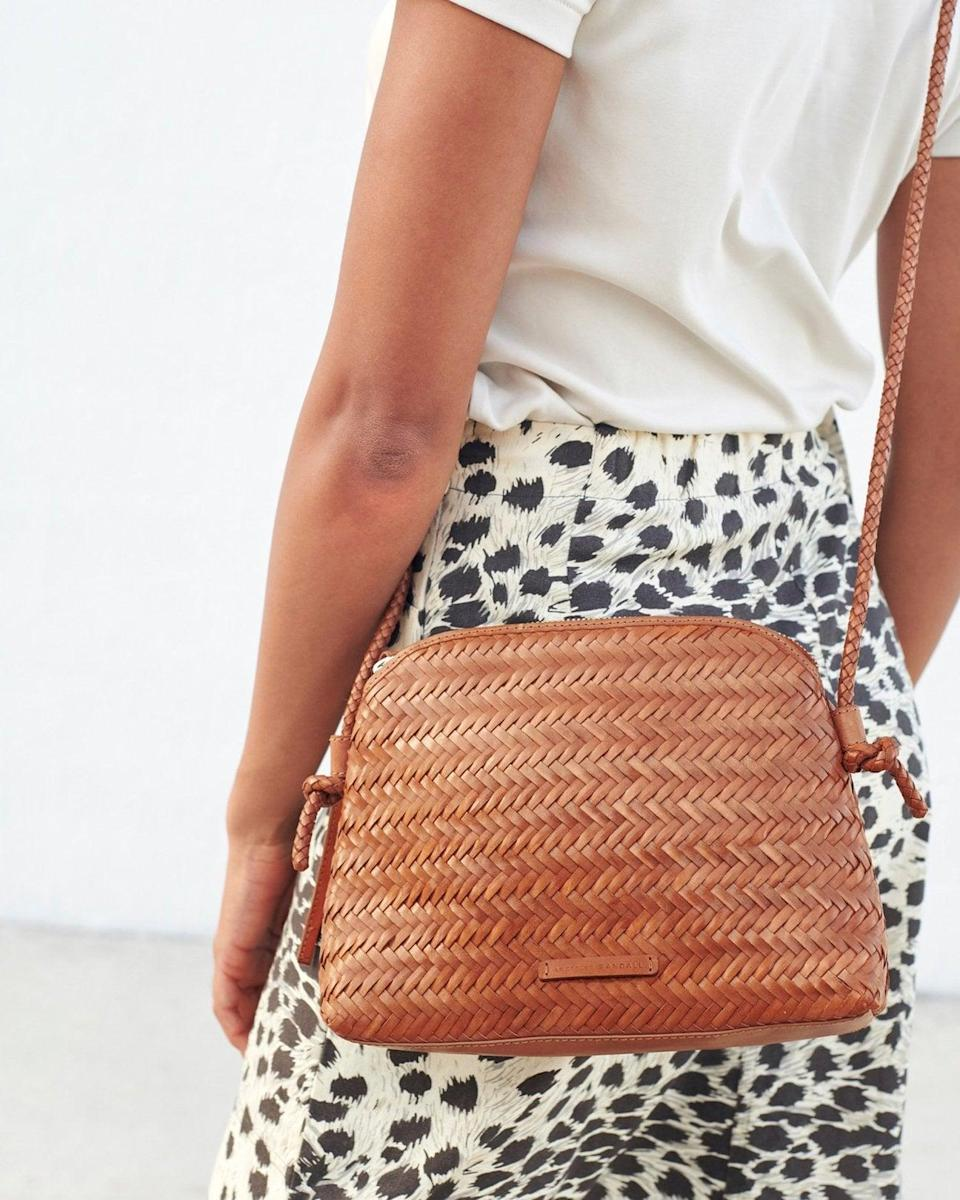 <p>The design of this <span>Loeffler Randall Mallory Woven Crossbody Timber Bag</span> ($295) makes it easy to pair with a variety of outfits.</p>