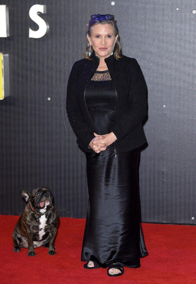 <p>Carrie Fisher and her beloved dog, Gary, at the European premiere of <em>Star Wars: The Force Awakens</em> on Dec. 16, 2015, in London. (Photo by Karwai Tang/WireImage)</p>