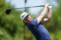 Cameron Smith, of Australia, hits off the second tee during the final round of the PGA Zurich Classic golf tournament at TPC Louisiana in Avondale, La., Sunday, April 25, 2021. (AP Photo/Gerald Herbert)