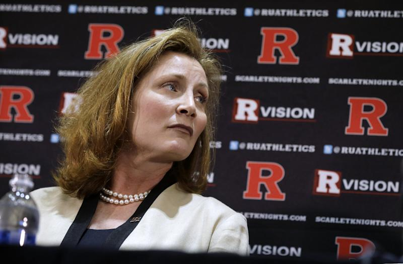 Julie Hermann listens as Rutgers President Robert Barchi announces Hermann as athletic director, Wednesday, May 15, 2013, in Piscataway, N.J. Hermann, who was Louisville's senior associate athletic director, will be the third female athletic director at a school among the 124 playing at college football's top tier. Rutgers has been looking for a new AD since Tim Pernetti resigned on April 5, part of the fallout from the Mike Rice scandal. (AP Photo/Mel Evans)