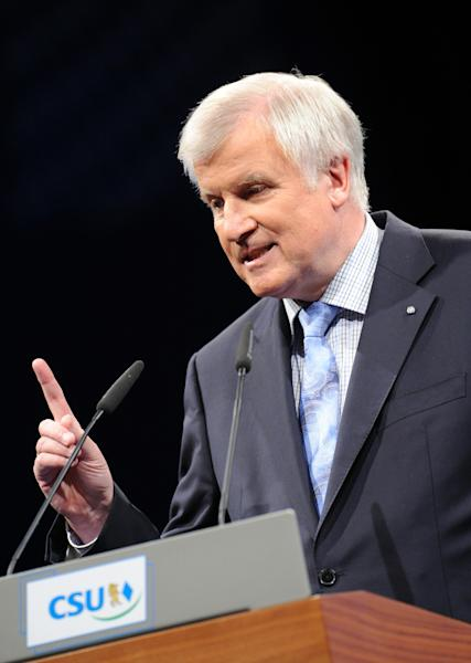 In this picture taken Thursday, Sept. 12, 2013, Governor of Bavaria and top candidate of the CSU Horst Seehofer speaks at the final rally of the Christian Social Union, CSU, of Bavaria for the Bavarian state elections in Munich. German Chancellor's Angela Merkel's conservatives hope to add momentum to the German leader's quest for a third term with a big state election win on Sunday in prosperous Bavaria — just a week before the whole country goes to the polls. (AP Photo/dpa, Andreas Gebert)