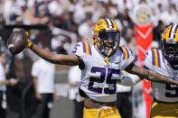 LSU cornerback Cordale Flott (25) celebrates intercepting a Mississippi State pass during the first half of an NCAA college football game, Saturday, Sept. 25, 2021, in Starkville, Miss. (AP Photo/Rogelio V. Solis)