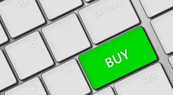 """white keyboard with """"buy"""" written on a green enter key (stocks to buy)"""