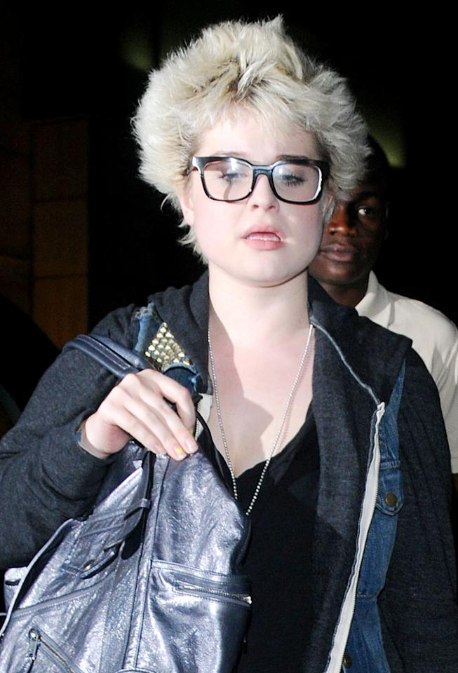 """Kelly Osbourne's crusty yellow fingernail polish and matching coif are beyond catastrophic. Goff/<a href=""""http://www.infdaily.com"""" target=""""new"""">INFDaily.com</a> - August 6, 2009"""