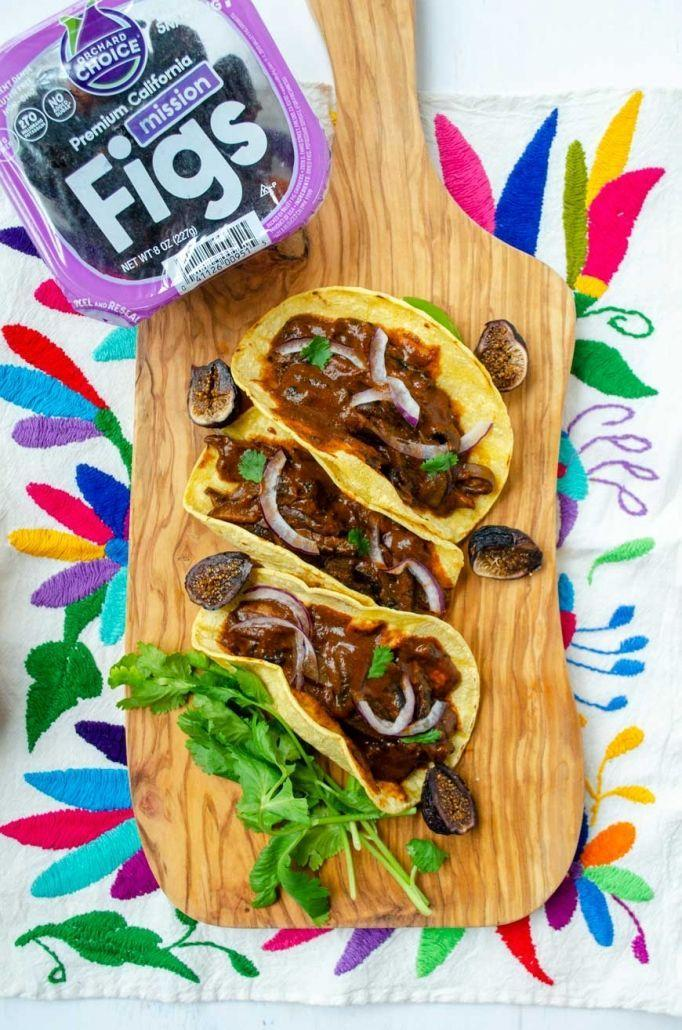 """<p>Treat yourself to the sweet and savory blend of fig and mole in your next batch of mushroom tacos (an unexpectedly amazing sweet and savory combo). It gets its spice from three different types of chile peppers and its heart-healthy fats and crunch from multiple nuts and seeds.</p><p><a class=""""link rapid-noclick-resp"""" href=""""https://dorastable.com/fig-mole-mushroom-tacos/"""" rel=""""nofollow noopener"""" target=""""_blank"""" data-ylk=""""slk:GET THE RECIPE"""">GET THE RECIPE</a></p><p><em>Per serving: 1,018 calories, 64 g fat (30 g saturated), 1,471 mg sodium, 103 g carbs, 32 g sugar, 22 g fiber, 25 g protein</em></p>"""