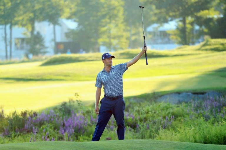 Webb Simpson rolled in an eagle from 70 feet to complete a bogey-free eight-under par 63 to stand on 11-under 131 after 36 holes at the PGA Dell Technologies Championship