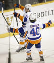 New York Islanders center Brock Nelson (29) celebrates with Michael Grabner (40), of Austria, after Nelson scored a goal in the third period giving the Islanders a 4-3 win over the Nashville Predators in an NHL hockey game Thursday, March 5, 2015, in Nashville, Tenn. (AP Photo/Mark Humphrey)