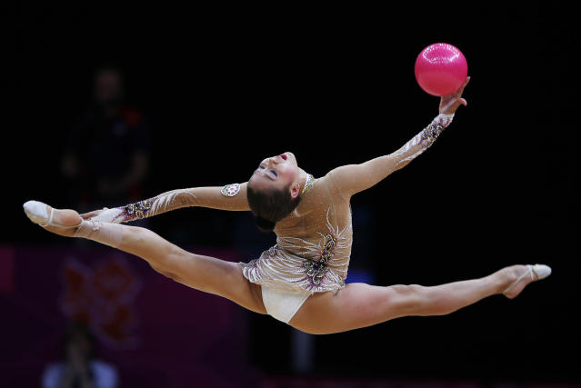 Azerbaijan's Aliya Garayeva competes using the ball in the individual all-around rhythmic gymnastics final at Wembley Arena during the London 2012 Olympic Games August 11, 2012. REUTERS/Marcelo Del Pozo (BRITAIN - Tags: SPORT GYMNASTICS OLYMPICS)