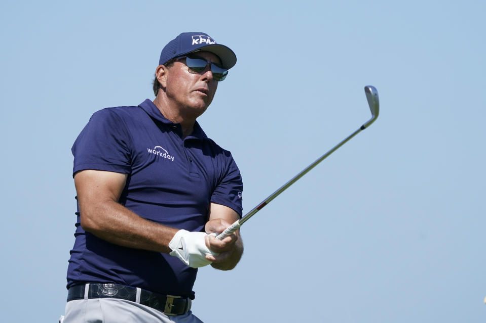 Phil Mickelson watches his shot off the fifth tee during the final round at the PGA Championship golf tournament on the Ocean Course, Sunday, May 23, 2021, in Kiawah Island, S.C. (AP Photo/Matt York)