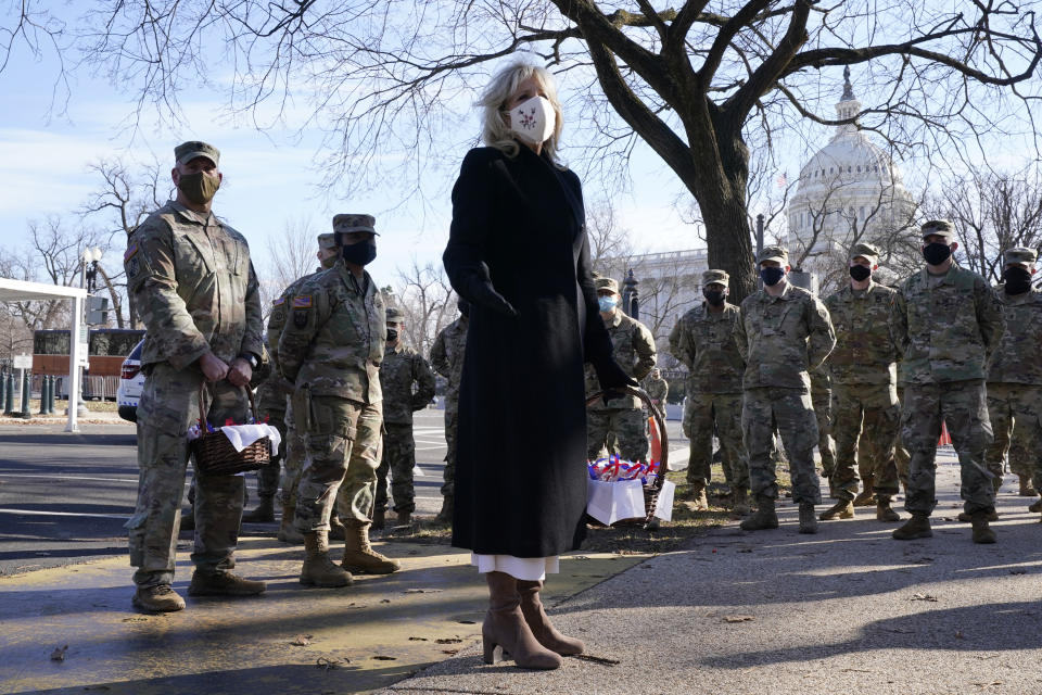 First lady Jill Biden surprises National Guard members outside the Capitol with chocolate chip cookies, Friday, Jan. 22, 2021, in Washington. (AP Photo/Jacquelyn Martin, Pool)
