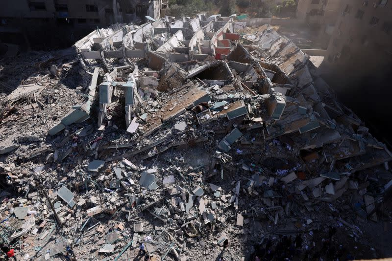 FILE PHOTO: A tower housing AP, Al Jazeera offices collapses after Israeli missile strikes in Gaza city