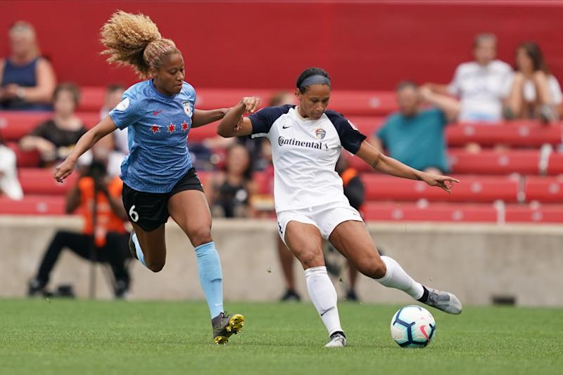 BRIDGEVIEW, IL - JULY 21: Chicago Red Stars defender Casey Short #6 defends against NC Courage forward Lynn Williams #9 during the NWLS soccer game between Chicago Red Stars and North Carolina Courage at SeatGeek Stadium on July 21, 2019 in Bridgeview, Illinois. (Photo by Daniela Porcelli/Getty Images)