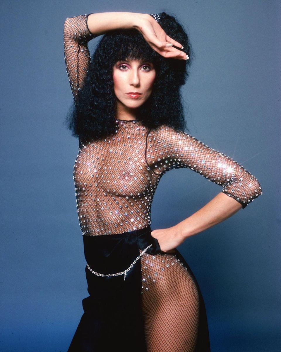 <p>In a sparkling see-through bodysuit by Bob Mackie for a portrait session. </p>