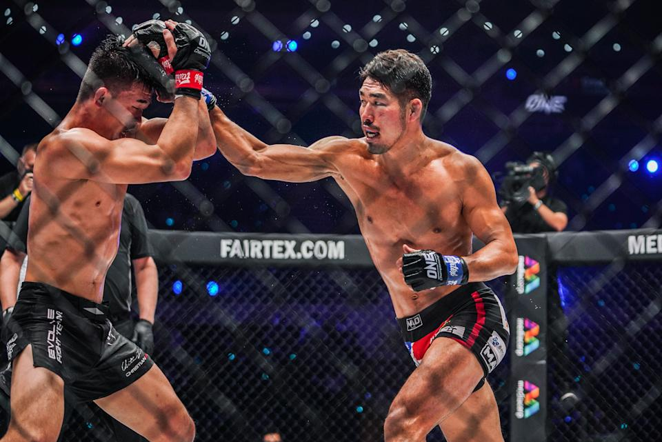 South Korea's Ok Rae-yoon (right) in action with Christian Lee in their ONE lightweight title bout at ONE: Revolution. (PHOTO: ONE Championship)