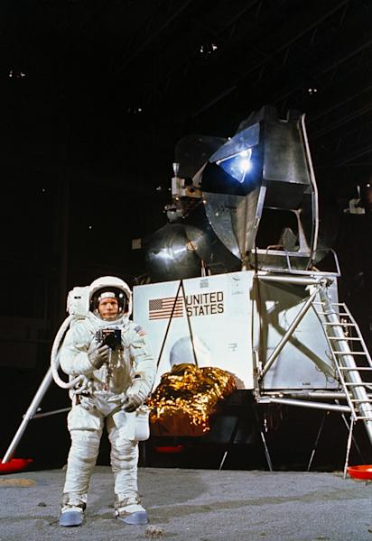 Astronaut Neil A. Armstrong, wearing an Extravehicular Mobility Unit, participates in a simulation of deploying and using lunar tools on the surface of the moon during a training exercise in Building 9 on April 22, 1969. Armstrong is the comman