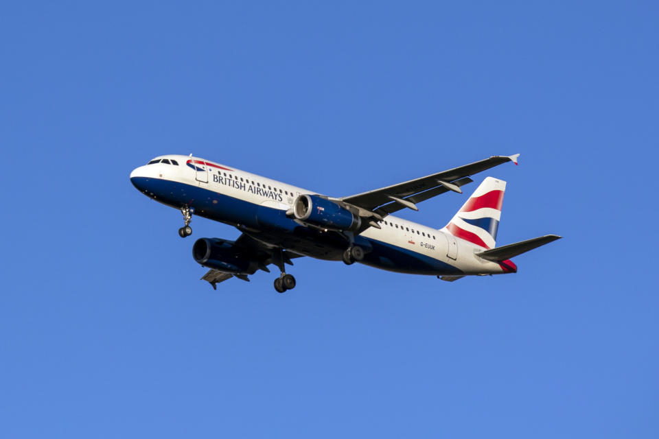 A British Airways Airbus A320-232 plane lands at Heathrow Airport in West London.