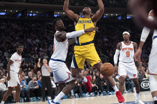 New York Knicks forward Julius Randle (30) fouls New York Knicks forward Bobby Portis (1) in the first half of an NBA basketball game, Friday, Feb. 21, 2020, at Madison Square Garden in New York. (AP Photo/Mary Altaffer)