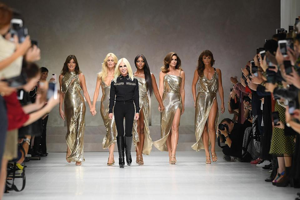 Carla Bruni-Sarkozy, Claudia Schiffer, Donatella Versace, Naomi Campbell, Cindy Crawford, and Helena Christensen walk the runway at the Versace show during Milan Fashion Week Spring/Summer 2018 on Sept. 22, 2017, in Milan, Italy. (Photo: Venturelli/WireImage)