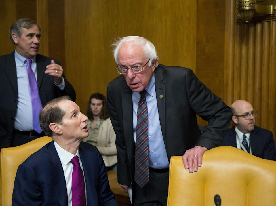 WASHINGTON, DC - NOVEMBER 28:  (L-R) Sen. Ron Wyden (D-OR) and Sen. Bernie Sanders (I-VT) speak before the full committee markup of the tax reform legislation on Capital Hill November 28, 2017 in Washington, DC. Republicans in the Senate hope to pass their legislation this week and work with the House of Representatives to get a bill to President Donald Trump before Christmas.   (Photo by Tasos Katopodis/Getty Images)