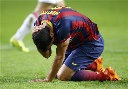 Barcelona's Martin Montoya reacts during a Champions League group H soccer match against Ajax Amsterdam at Amsterdam Arena November 26, 2013. REUTERS/Michael Kooren
