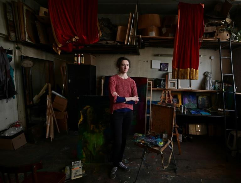 Artist Polina Surovova, 28, is one of the last occupants of a Khrushchyovka where residents received eviction notices in August last year