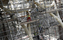 In this Oct. 8, 2019, photo, laborers work on the Al Wasl Dome at the under construction site of the Expo 2020 in Dubai, United Arab Emirates. The preparations for Expo 2020 come as Dubai's real estate market show signs of faltering amid global economic woes. Fears of military conflict across the Persian Gulf cloud organizers' sunny projections. (AP Photo/Kamran Jebreili)