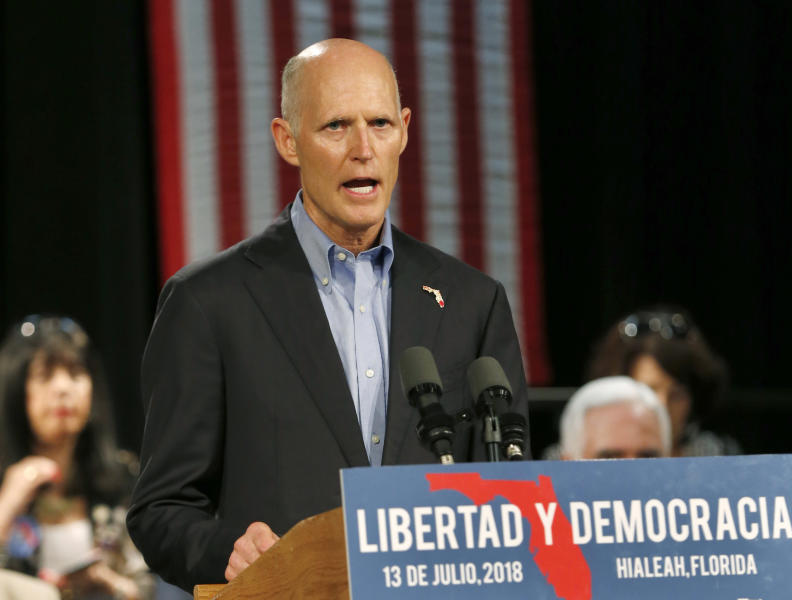 FILE - In this July 13, 2018, file photo, Florida Gov. Rick Scott, speaks to Cuban-American supporters at a campaign stop, in Hialeah, Fla. Scott is getting back on the campaign trail after spending more than two weeks dealing with the aftermath of Hurricane Michael. Despite being embroiled in a tight race with U.S. Sen. Bill Nelson, Scott has spent most of his time in the Florida Panhandle counties damaged by the deadly storm. (AP Photo/Wilfredo Lee, File)