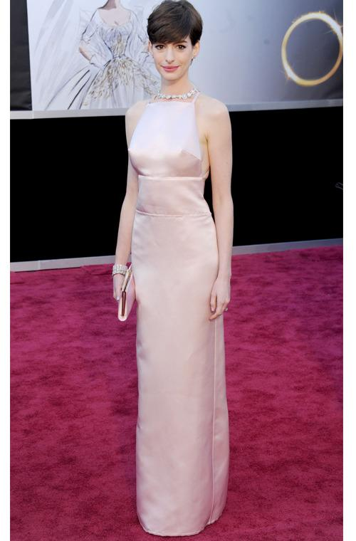 <p>While this pale pink, satin Prada gown may have been the talk of the world for all of the wrong reasons  when Anne Hawathay won an Oscar in 2013, (who could forget 'nipplegate'), it was tailored to the Les Miserables star's figure to perfection and was simply exquisite.</p>